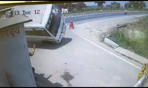 Stunning moment SUV crashes into bus and flips it over on Indian road