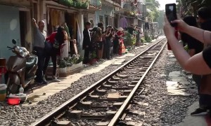 Train Passes Through Tiny Street in Vietnam