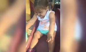 Toddler Girl Gets Stuck on Playground Slide