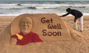 Sand artist in India carves 'Get Well' message for recently ill Dalai Lama