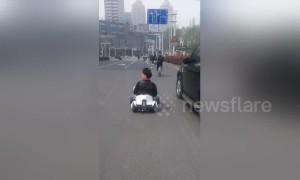 Miniature motorist? Chinese man drives go-kart along busy road