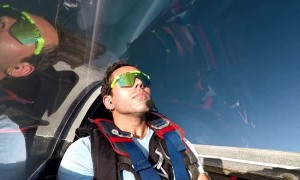 Stunt Pilot Snacks on Pizza