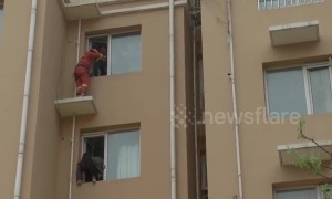 Fireman kicks suicidal girl back to safety in China's Hebei