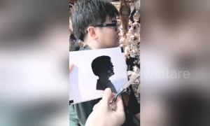 Astonishing Chinese street artist cuts paper profiles in one minute
