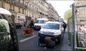 Man performs bizarre dance for police during yellow vest protest in Paris