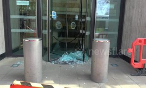 Climate change activists smash windows at Shell's London HQ
