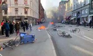 Angry demonstrators light fires on streets of Copenhagen