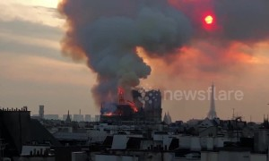 Moment part of Notre Dame spire collapses in Paris