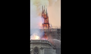 Moment Notre Dame's spire collapses during massive fire