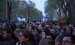 Parisians watch in stunned silence as Notre Dame goes up in flames