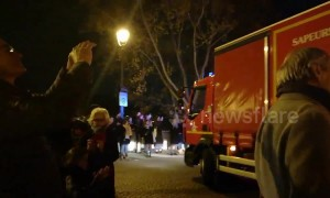 Parisians applaud firefighters following Notre Dame fire