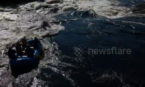 White water raft carrying 5 people is flipped over by huge wave on Gatineau River, Canada