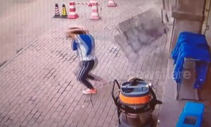 Chinese man has lucky escape avoiding falling marble blocks