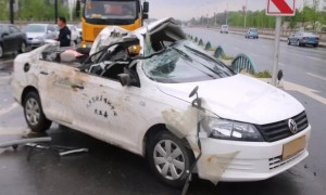 Out-of-control lorry slides into car and rips its roof off in China