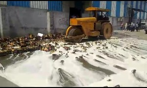 Indian authorities steam-roller more than 11,000 cans of expired beer