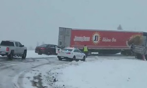 State Trooper Pushes Semi Stuck in Snow