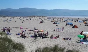 Hotter than Spain! Rare Easter heatwave packs Wales beach