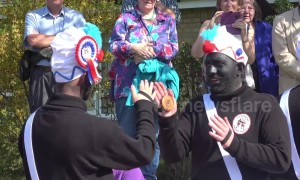 Controversial dance group 'blacks up' for annual Easter tradition