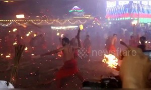 Indian devotees engage in fire-throwing fight to appease Hindu goddess