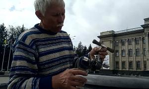 Man Rides Teeny Tiny Bicycle