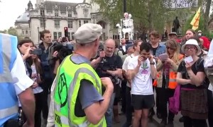 Extinction Rebellion crowd repeat instructions in bizarre call and response