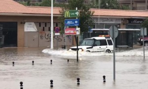 UK tourist spots cars wading through deep water as Spanish town flooded