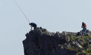 Spanish fishermen risk their lives catching sea bream from top of steep cliff