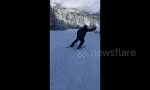Ski instructor gives screaming encouragement to student in Bosnian mountains