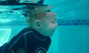 Baby incredibly jumps in and swims all the way across pool