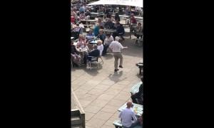 Having the time of his life! Elderly man dances in front of crowd in beer garden