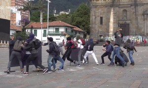 Protesters clash with riot police during nation-wide strike in Colombia