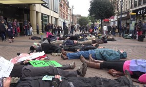 Protesters perform 'die-in' on West London high street