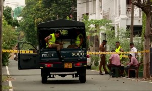 Police work outside expensive home of two of the Sri Lanka attackers