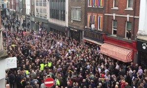Homophobic nail-bomb attack remembered by defiant crowd-rousing street choir