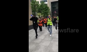 Employees of the catering service for London's Facebook headquarters hold protest