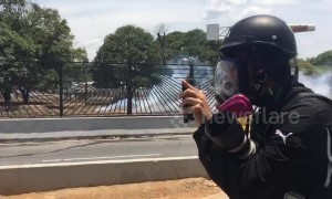 Gunfire and screams heard as protesters in Caracas flee amid clashes