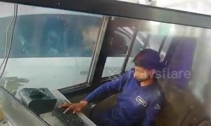 Cheeky monkey caught on camera stealing money from toll booth worker in northern India