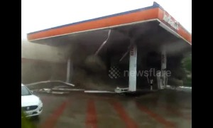 Dramatic moment Indian petrol station is engulfed in dust by cyclone winds