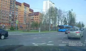 Russian Cyclist Collides with a Car