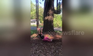 2-year-old falls off her swing in slow motion when dad pushes her