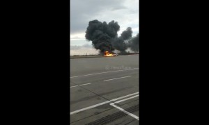 Passengers escape burning Aeroflot jet using emergency slides