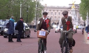 Scores of people ride through London dressed in tweed