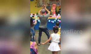 Supportive Filipino father steals the show after dancing along with daughter
