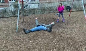 Canada dad ends up flat on his back after failed flip off swing set