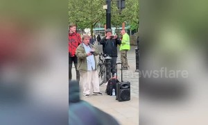 Preachers in Manchester argue across the street in 'Christian Soundclash'