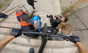 French mountain biker narrowly avoids smashing into group of people sitting on stairs