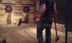 Canadian axe thrower makes incredible underarm and overarm double bullseye