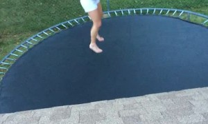 Back Flip on Trampoline Sends Girl to the Ground