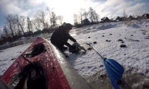 Swan Stuck to Ice Rescued by Men in Kayak