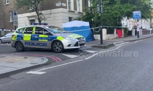 Man's body found in wheelie bin in north London